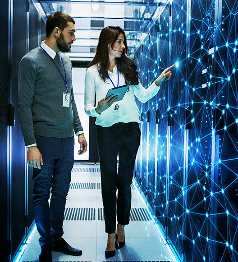 female and nale it engineers discussing technical details in a working data server room with internet connection visualisation